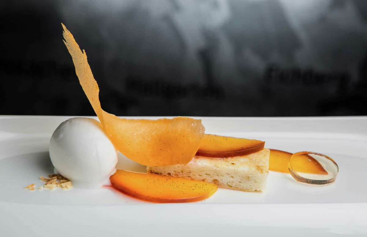 Almond tonka bean cake with peaches, coconut kaffir lime sorbet and grand marnier gel at Cureight