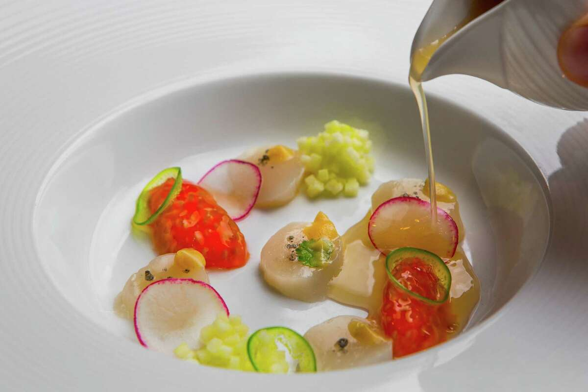 Cureight serves a crudo of bay scallop, brown butter, tomato hearts and apple dashi.