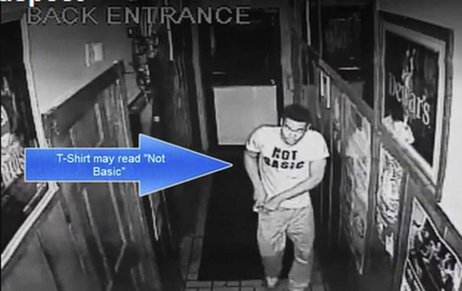 Police say the man caught on this security video breaking into a downtown bar is Carl Dawkins, 24, whom they charged with conducting a spate of downtown burglaries over Labor Day weekend. Photo: Contributed / Contributed Photo / Stamford Advocate contributed