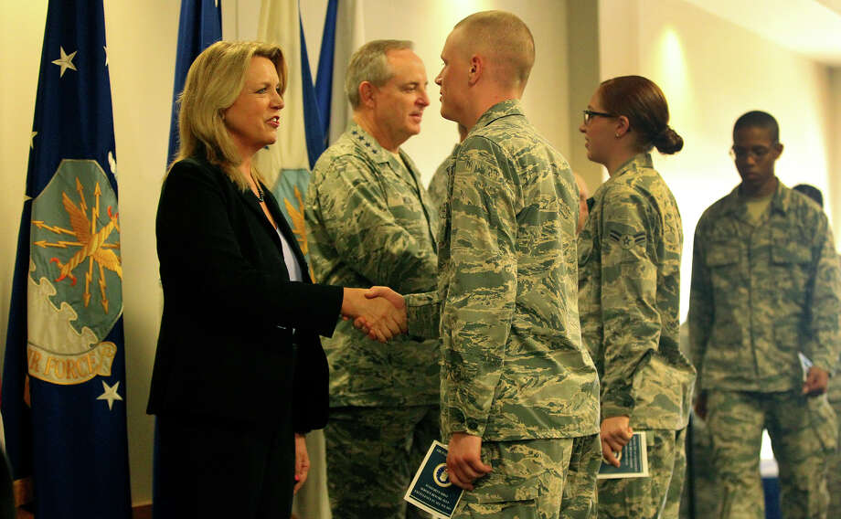 Air Force Secretary Deborah Lee James (left) and General Mark A. Welsh III (stars on collar) shake hands with airmen Thursday August 27, 2015 at the Pfingston Center at Lackland Air Force Base. James, Welsh and Chief Master Sergeant James Cody (not visible) were on hand to congratulate airmen who took part in a character building program called Capstone during Airmen's Week which was created by General Mark A. Welsh III. The program was created to help reinforce the Air Force's core values. Photo: John Davenport, Staff / San Antonio Express-News / ©San Antonio Express-News/John Davenport