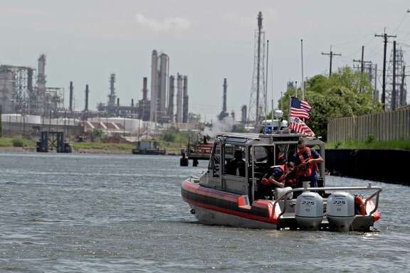 The U.S. Coast Guard monitors vessel traffic on the Houston Ship Channel for safety, but doesn't play a role in coordinating transits.  (James Nielsen / Houston Chronicle )
