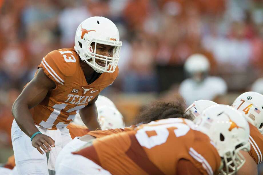 Jerrod Heard of the Texas Longhorns calls a play at the line of scrimmage against the Rice Owls during the first quarter on Sept. 12, 2015 at Royal-Memorial Stadium in Austin. Photo: Cooper Neill /Getty Images / 2015 Getty Images