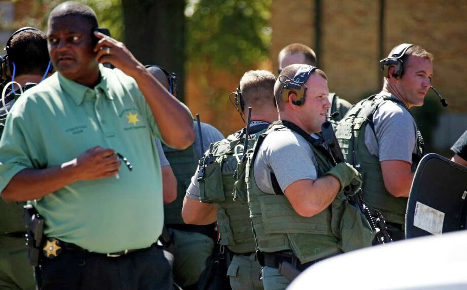 Law enforcement officers search the Delta State University campus in Cleveland, Miss., for an active shooter in connection with a the death of history professor Ethan Schmidt, who was shot in the head in his office on Monday. Photo: Rogelio V. Solis, STF / AP