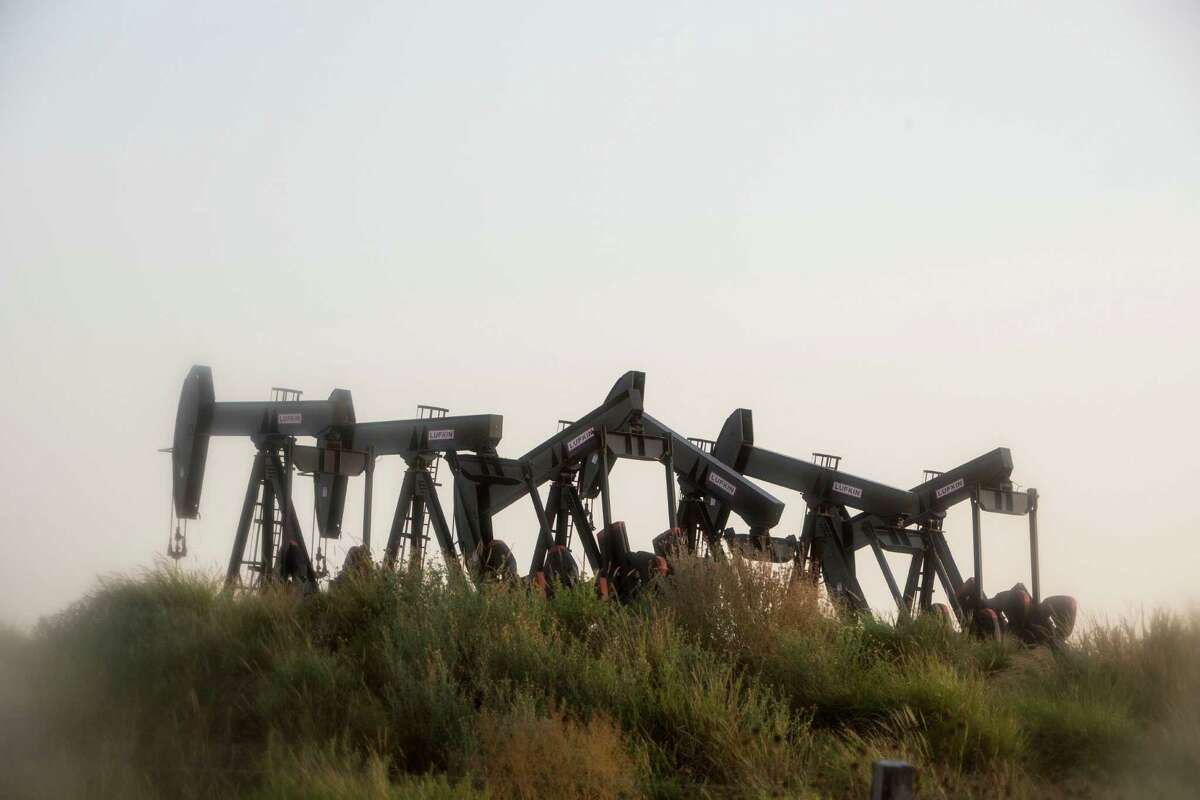 Six pumpjacks stand outside of Cotulla. Even though 73 percent of the nation's oil rigs have been sidelined since October 2014, U.S. crude production has slipped less than 5 percent from its peak in April, according to data compiled by the Federal Reserve Bank of Dallas.