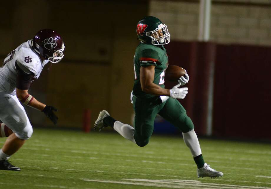 The Woodlands senior defensive back Antoine Winfield Jr., right, outruns a Cy-Fair defender on a punt return during their season opener at Woodforest Bank Stadium in Shenandoah on August 28, 2015. (Photo by Jerry baker/Freelance) Photo: Jerry Baker, Freelance
