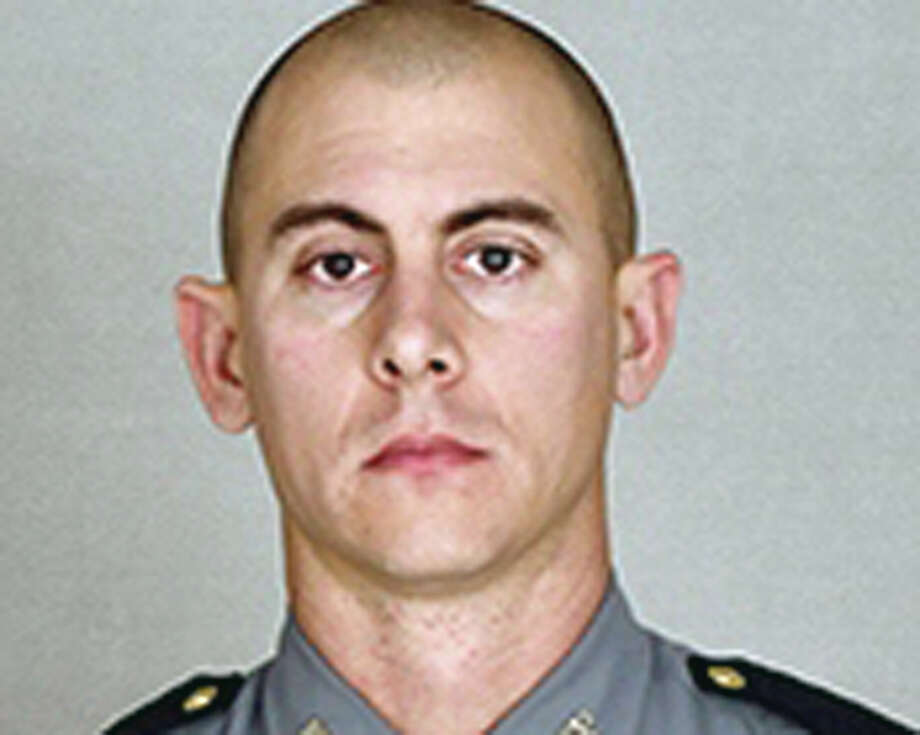 This undated photo provided by the Kentucky State Police shows Trooper Joseph Cameron Ponder. Ponder, who had been on the force less than a year was killed, late Sunday, Sept. 13, 2015, in a shooting during a car chase. Authorities are searching for the suspect. (Courtesy of the Kentucky State Police via AP) Photo: HONS / Kentucky State Police