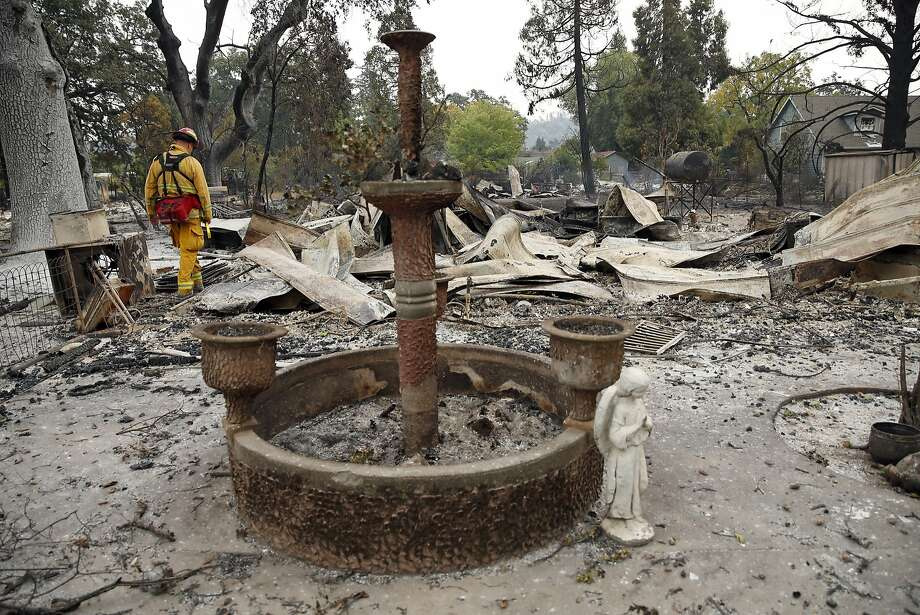A firefighter surveys the result of the Valley Fire on Barnes Street in Middletown, Calif., on Monday, September 14, 2015. Photo: Scott Strazzante, The Chronicle