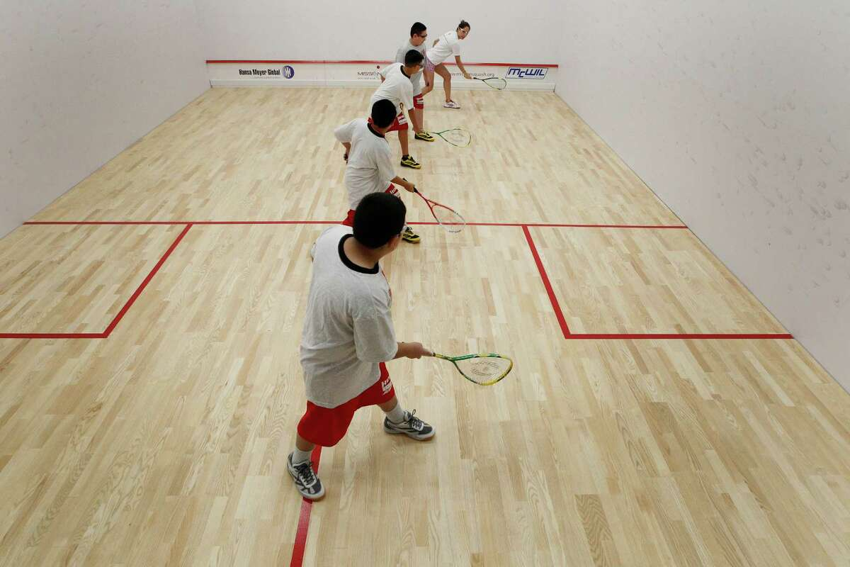 Hogg Middle School students start their first lesson in Squash by Squash Director Darya Musavi (left) Tuesday, Sept. 8, 2015, in Houston. The school recently constructed squash courts, which are the first squash courts at a public school in the country.