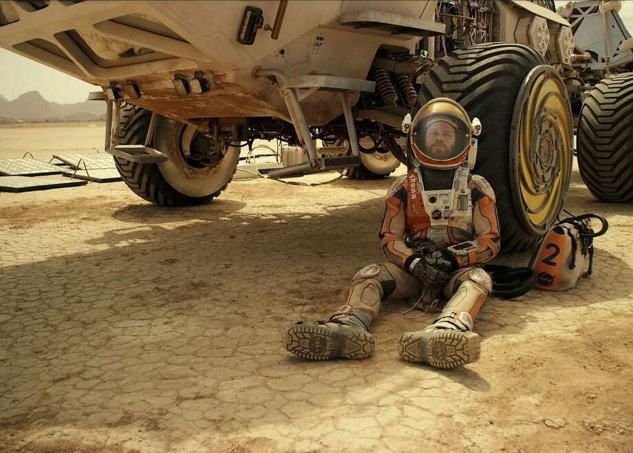 "BURNING OUT HIS FUSE UP HERE ALONE Mark Watney (Matt Damon) may be reaching the very end of his considerable ingenuity in his struggle to survive alone on Mars in ""The Martian."" Ridley Scott's new movie opens Oct. 2.  Photo: Courtesy of Twentieth Century Fox Photo: Photo Credit: Courtesy Twentieth, Courtesy Of Twentieth Century Fo"