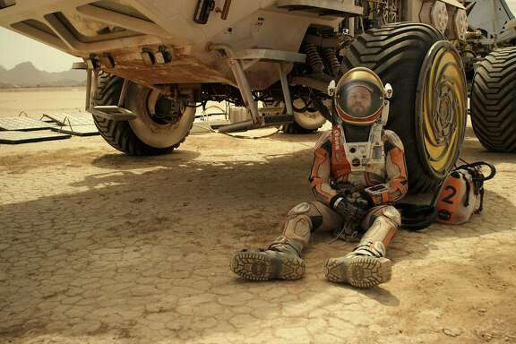 "BURNING OUT HIS FUSE UP HERE ALONE Mark Watney (Matt Damon) may be reaching the very end of his considerable ingenuity in his struggle to survive alone on Mars in ""The Martian."" Ridley Scott's new movie opens Oct. 2.  Photo: Courtesy of Twentieth Century Fox"