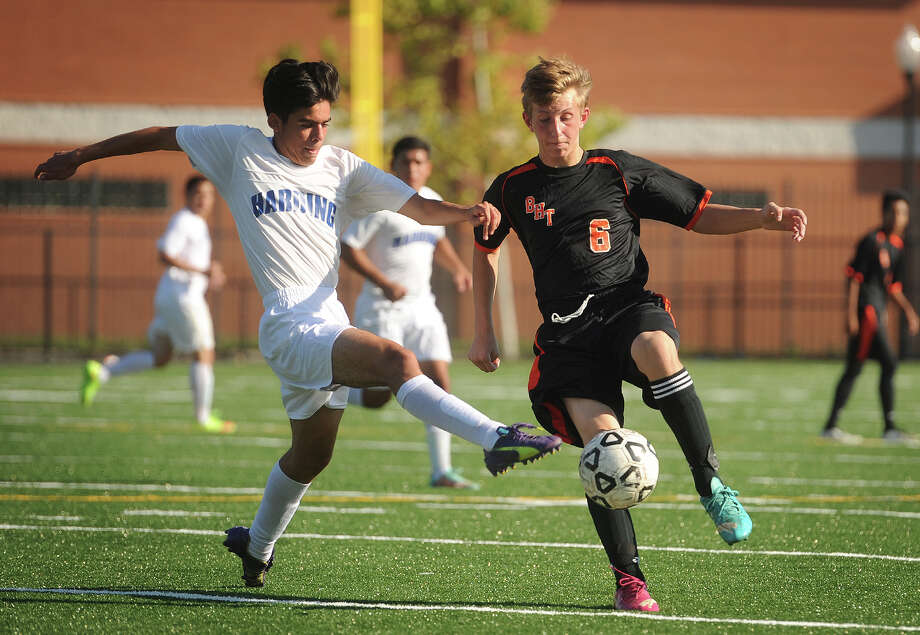 Harding's Edgar Valencia, left, battles for the ball with Bullard-Havens' Chris Sowinski during their match Monday at Luis Munoz Marin School in Bridgeport. Photo: Brian A. Pounds / Hearst Connecticut Media / Connecticut Post