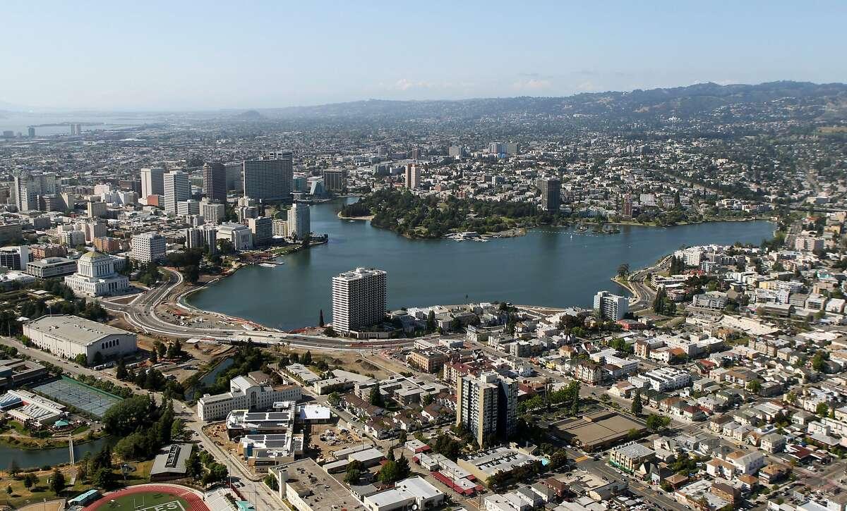 The Oakland skyline rises above Lake Merritt.