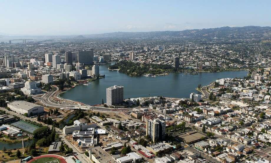 The Oakland skyline rises above Lake Merritt. Photo: Lance Iversen, The Chronicle