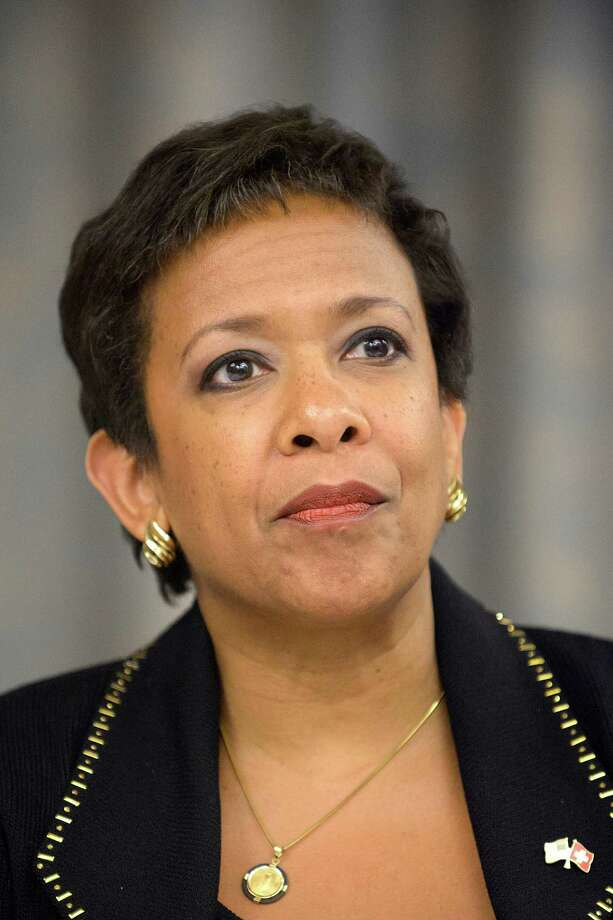 Loretta Lynch, attorney general of the US attends a news conference on soccer related criminal proceedings, in Zurich, Switzerland, Monday, Sept. 14, 2015. Lynch expects more indictments in FIFA corruption investigation. (Anthony Anex/Keystone via AP) ORG XMIT: LGL105 Photo: Anthony Anex / KEYSTONE