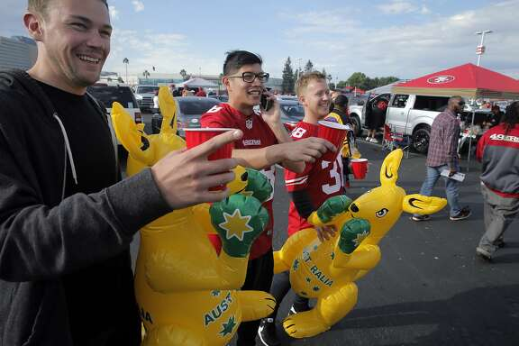 Australian fans of Jarryd Hayne, l-r, Nick Macrae, Andrew Bavy-Hou, and Nick Gibbeson, carry their inflatable kangaroos in the parking lot before the start of the 49ers game against the Minnesota Vikings at Levi's Stadium in Santa Clara, Calif., on Monday, September 14, 2015. All three are from Sydney and Gibbeson and Bavy-Hou came from Sydney along with Macrae who recently moved to the Peninsula.