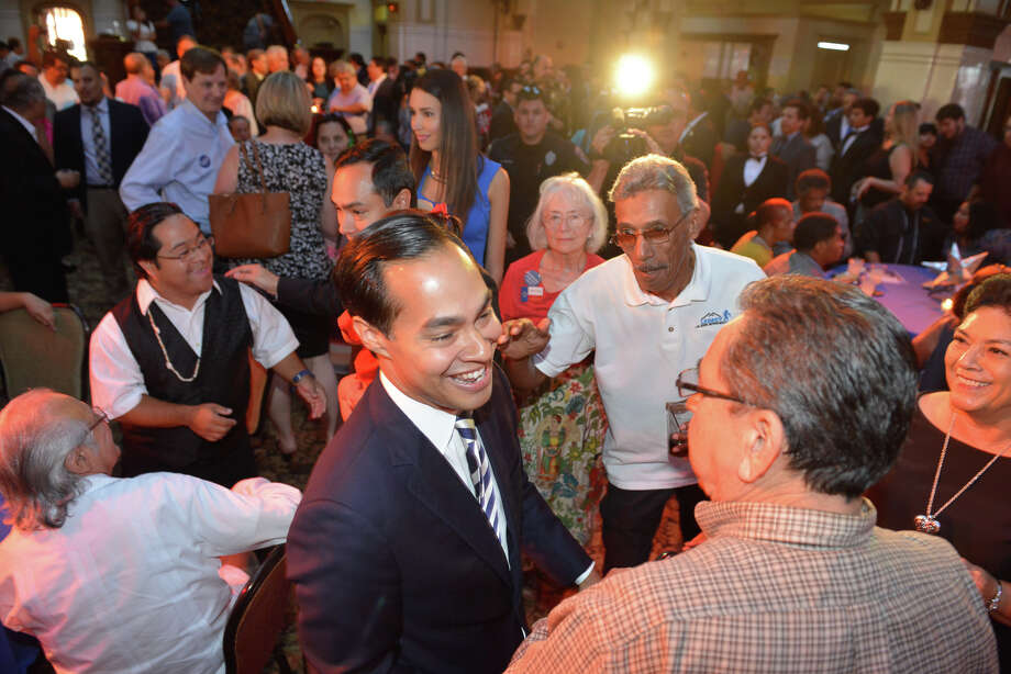 U.S. Housing and Urban Development Secretary Julian Castro greets well-wishers during the annual Texas Democratic Party birthday celebration Monday at Sunset Station for the him and brother, Congressman Joaquin Castro, who are turning. 41. Photo: Robin Jerstad / San Antonio Express-News