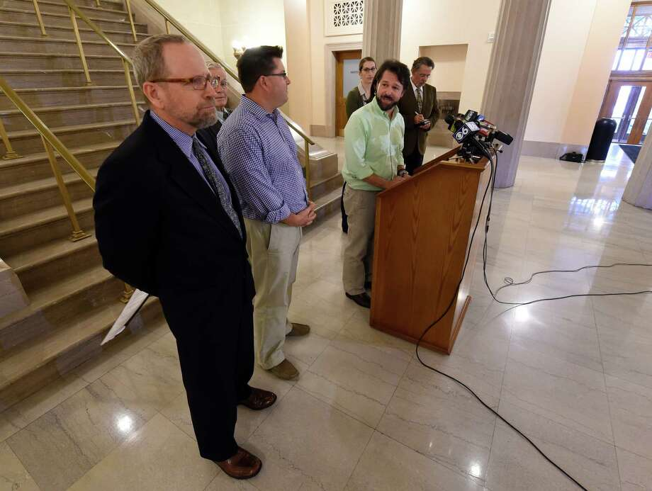 Albany County Legislator Bryan Clenahan calls for micro bead laden products to be taken from the shelves of businesses in the County, Monday morning during a press conference in the Albany County Courthouse Sept. 14, 2015 in Albany, N.Y.   (Skip Dickstein/Times Union) Photo: SKIP DICKSTEIN / 00033340A