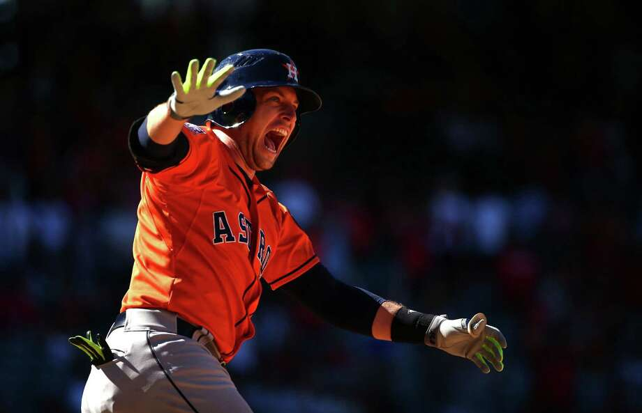 The Astros' Jed Lowrie celebrates after hitting a three-run homer in the ninth inning to complete a comeback for a 5-3 win over the Angels. Photo: Victor Decolongon, Stringer / 2015 Getty Images