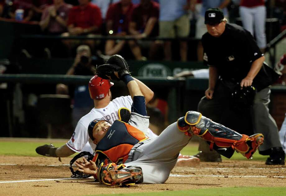 6d65452b1a9186 Houston Astros catcher Hank Conger holds his glove up containing the ball  after tagging out Texas