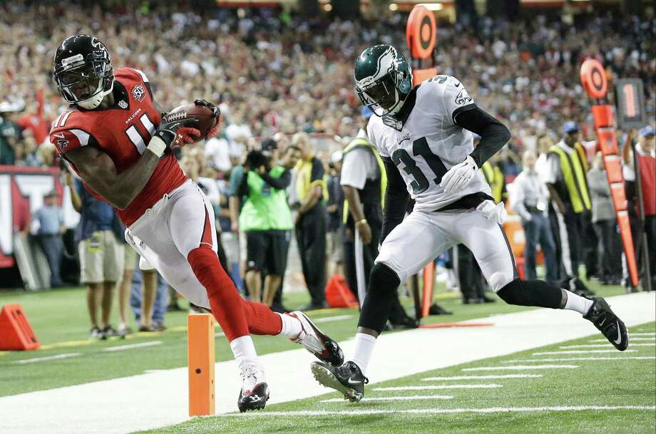 Atlanta Falcons wide receiver Julio Jones (11) makes a touchdown catch against Philadelphia Eagles defensive back Byron Maxwell (31) during the first half of an NFL football game, Monday, Sept. 14, 2015, in Atlanta. (AP Photo/Brynn Anderson) ORG XMIT: GAMS123 Photo: Brynn Anderson / AP