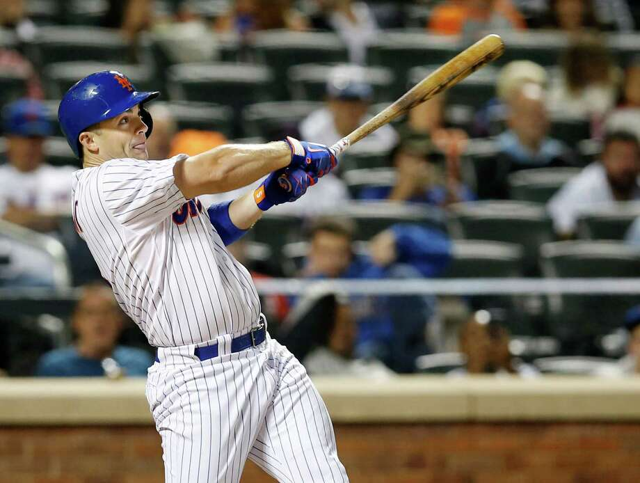 New York Mets David Wright hits a seventh-inning, RBI, ground-rule double in a baseball game against the Miami Marlins in New York, Monday, Sept. 14, 2015. (AP Photo/Kathy Willens) ORG XMIT: NYM116 Photo: Kathy Willens / AP