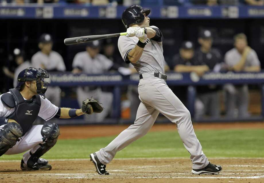 New York Yankees' Slade Heathcott follows the flight of his three-run home run off Tampa Bay Rays relief pitcher Brad Boxberger during the ninth inning of a baseball game Monday, Sept. 14, 2015, in St. Petersburg, Fla. (AP Photo/Chris O'Meara)  ORG XMIT: SPD116 Photo: Chris O'Meara / AP
