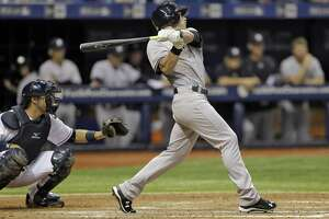 New York Yankees' Slade Heathcott follows the flight of his three-run home run off Tampa Bay Rays relief pitcher Brad Boxberger during the ninth inning of a baseball game Monday, Sept. 14, 2015, in St. Petersburg, Fla.  Catching for the Rays is J.P. Arencibia. (AP Photo/Chris O'Meara)  ORG XMIT: SPD116