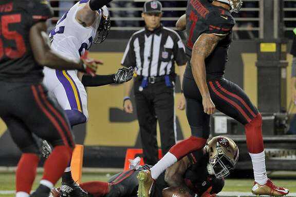 Carlos Hyde (28) dives into the end zone for his second quarter touchdown during the 49ers game against the Minnesota Vikings at Levi's Stadium in Santa Clara, Calif., on Monday, September 14, 2015.