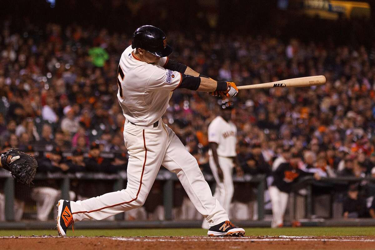 Matt Duffy of the San Francisco Giants hits a two-run double against the Cincinnati Reds during the first inning at AT&T Park on September 14, 2015 in San Francisco, California.