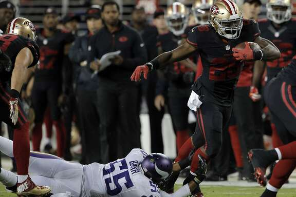 Carlos Hyde (28) runs in the first quarter during the 49ers game against the Minnesota Vikings at Levi's Stadium in Santa Clara, Calif., on Monday, September 14, 2015.
