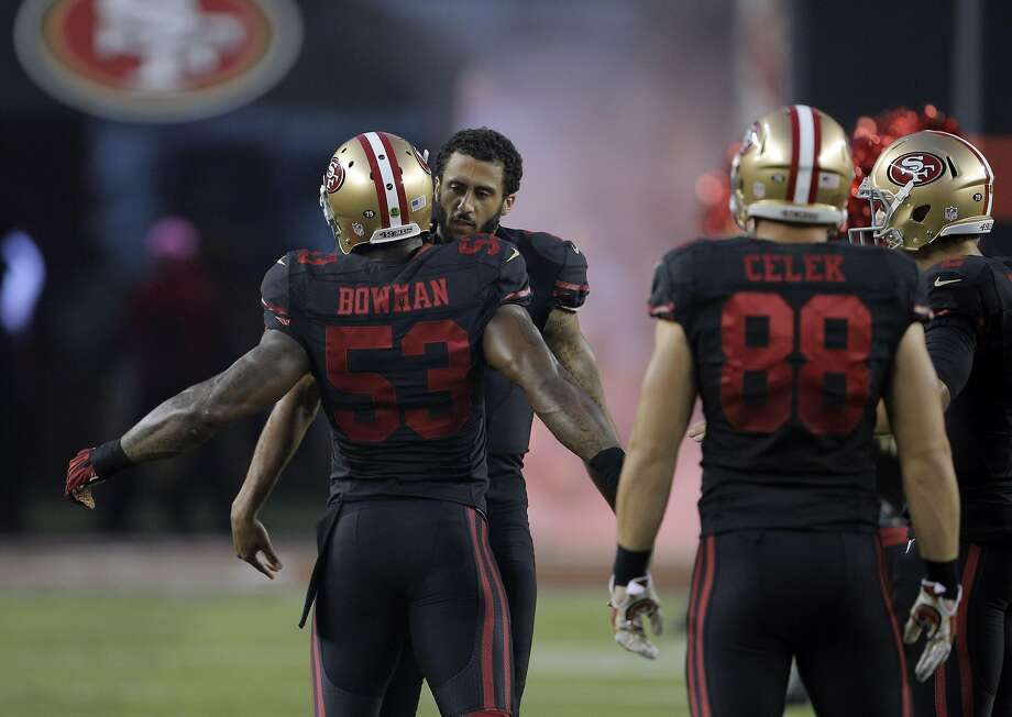 The 49ers were already making contact when NaVorro Bowman greeted teammate Colin Kaepernick before the game. Photo: Carlos Avila Gonzalez, The Chronicle