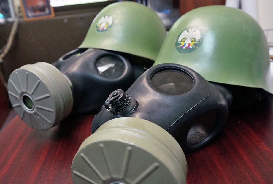Two 19-year-old Fairfield residents were charged with breach of peace after they were spotted driving down the Post Road wearinng these gas masks and helmets. Photo: Genevieve Reilly /Fairfield Citizen / Fairfield Citizen