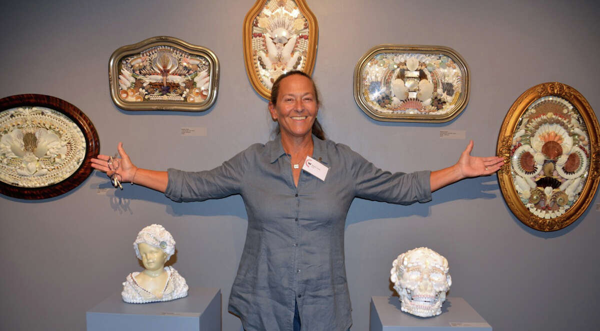 Artist Susan Lloyd next to her works at the recent Pop Up exhibit of the Westport Artists' Collective.