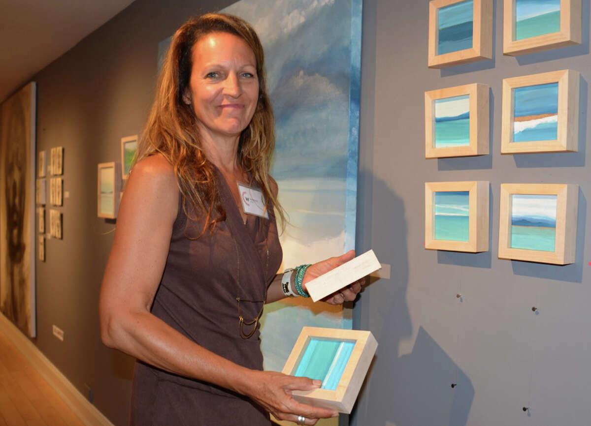 Dayan Moore prepares the display of her art work for the recent Pop Up exhibit of the Westport Artists' Collective.