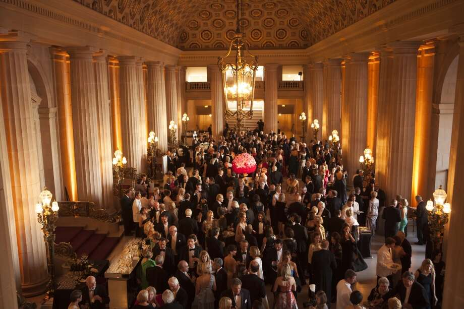 Guests mingle during cocktail hour at the San Francisco Opera's 93rd Season Opera Ball in San Francisco on Friday, Sept. 11, 2015. The theme of this year's ball was 'Moonlight & Music'. Photo: Alex Washburn, Special To The Chronicle