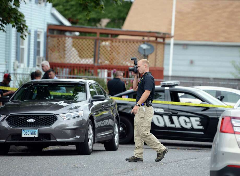 A town police officer shot a suspect while serving a search warrant early Friday at a home at 25 Yarwood St. in Stratford, Conn., a Stratford police spokesman said. Photo: Autumn Driscoll / Hearst Connecticut Media / Connecticut Post