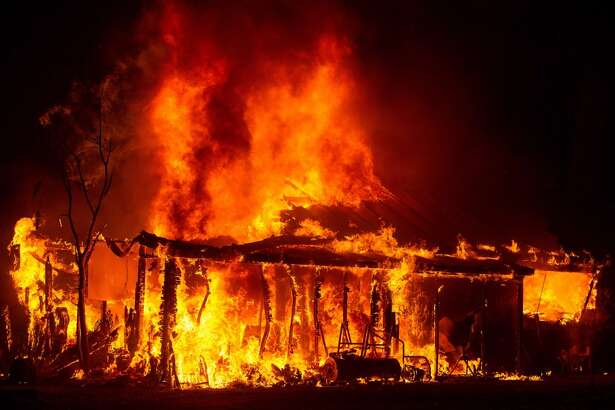 A house is engulfed in flames during the Valley fire in Seigler Springs, California on September 13, 2015. The governor of California declared a state of emergency Sunday as raging wildfires spread in the northern part of the drought-ridden US state, forcing thousands to flee the flames. The town of Middletown, population 1,300, was particularly devastated by the Valley Fire, according to local daily Santa Rosa Press-Democrat, which said the fire grew from 50 acres to 10,000 over just five hours Saturday -- before quadrupling in size overnight.