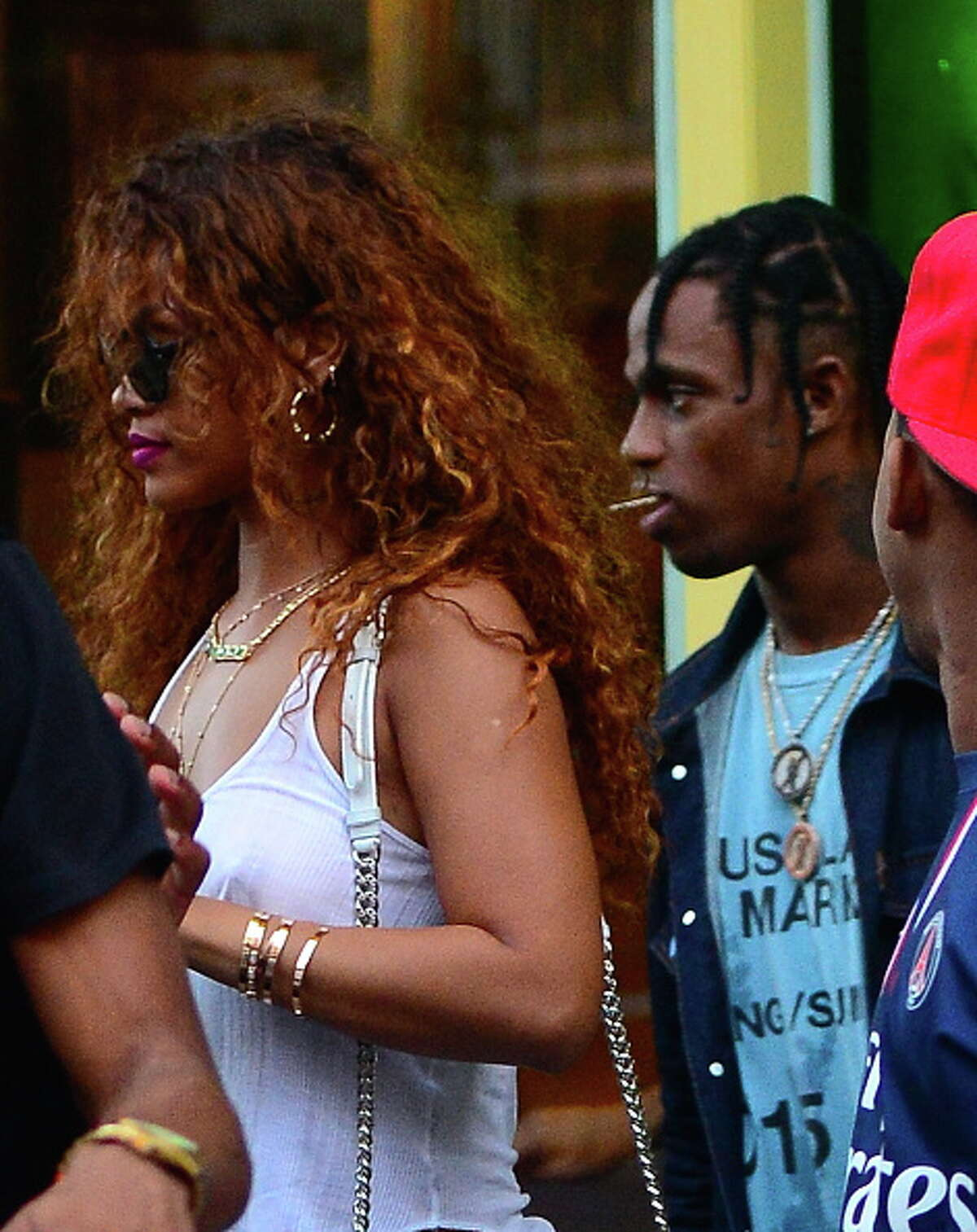 NEW YORK, NY - AUGUST 12: Singer Rihanna and Travis Scott are seen coming out of Coppelia restaurant in Soho on August 12, 2015 in New York City. (Photo by Raymond Hall/GC Images)