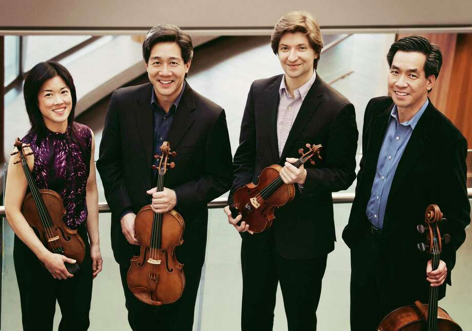 Ying Quartet members from left are Janet Ying (violin), Phillip Ying (viola) new first violinist Robin Scott, and David Ying (cello). Photo: J. Adam Fenster / Contributed Photo / J. Adam Fenster / University of Rochester