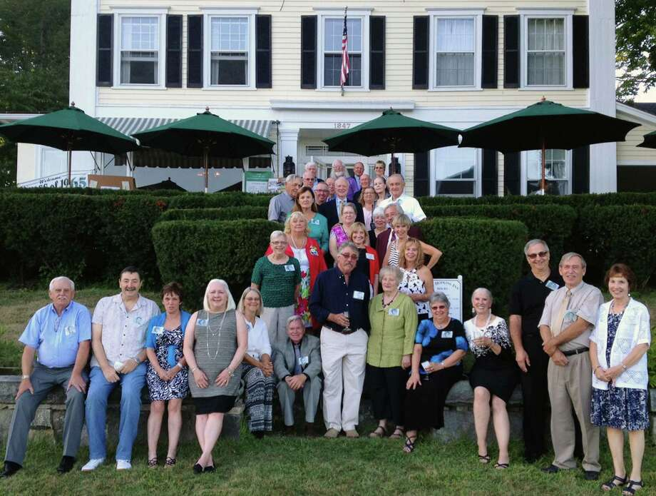 Class members and guests at the Class Dinner on Saturday evening gather for a group photo on the front steps to The Hopkins Inn. Participants are, from left to right, front row, Donald Earl, Jim Sega, Mary Hipp Kalivas, Chee Chee Rohr Suarez, Sandy Hyatt Bausch, Alan Case, Eric Lundgren, Cynthia Osborne, Charlene Ohmen Janecek, Jessica Broghan (Peggy Halloran), Jim Richardson, Ken Hipp and Josie Hipp; second row, Eva Colburn and Mary Jane Bellion Lundgren; third row, Susie Hampsey Daigle, Sharon O'Brien and Carolyn Jayne; fourth row, Mary Jane Dodd Williamson, Patsy Earl, Candy Bortniak Delancy and Mike Shanks; fifth row, Dave Williamson, John Anderson, Fred Allen, Lynn Aldrich Webster, Carol Hallock and John Delancy; sixth row, Bob Webster, Bob Asman and Terry Beninson; and back row, Bill Liedlich, Art Cummings, Robin Carlson and Clare Greiner. Photo: Norm Cummings / The News-Times