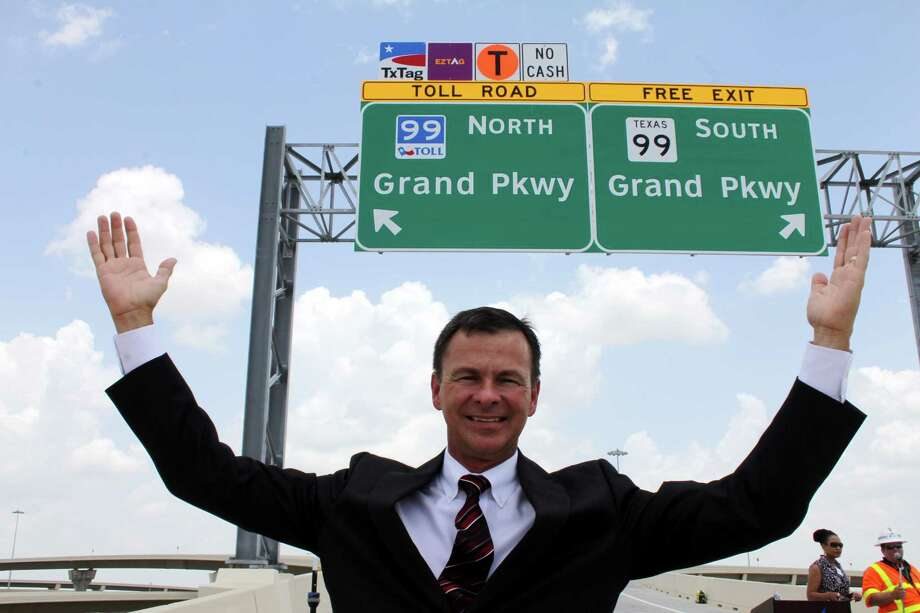 Expansion of the Grand Parkway brings more traffic, to an area and now Harris County is looking at projects to improve roads connecting to the parkway. Above, David Gornet, Grand Parkway Association executive director, celebrates completion of two direct connectors at Interstate 10 and Texas 99 in June 2014. Photo: Suzanne Rehak, Freelance Photographer
