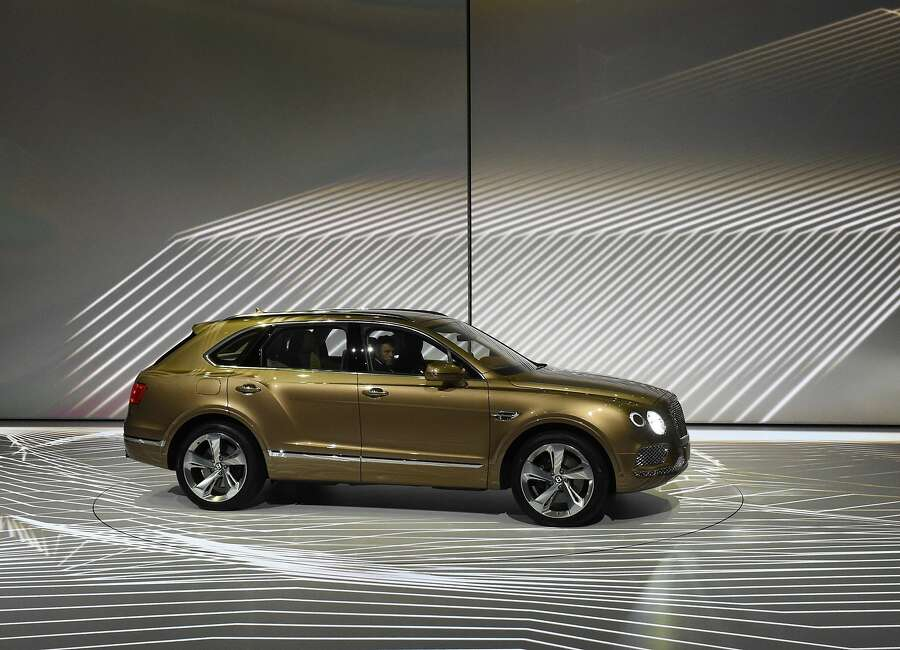 Volkswagen's luxury brand Bentley launched the Bentayga, billed as the most exclusive and luxurious SUV in the world and the brand's most technologically advanced car ever.  The Bentayga has a massive 12-cylinder engine and a top speed of 187 mph (301 kph). It also has all the technology one expects in a luxury car, including a park assist to help squeeze into tight spots, infrared to see wildlife at night as well as integrated wifi, navigation and entertainment systems.  But Bentley's charm lies also in its exclusive artisanal accents. Buyers can opt for an integrated event seat for watching polo matches from the comfort of the car, and can be fitted with three hampers for champagne, tea service and nibbles. The hampers can be removed as portable seating. The handcrafted interior can include a Breitling dashboard clock in white gold, mother of pearl and diamonds that winds itself and costs as much as the car.  While the concept was ballyhooed as a product for the Gulf states, the recovery in the U.S. and European markets has broadened the market considerably.  Plug-in electric and diesel versions are planned. The Bentayga will sell for 175,200 euros in Europe and $221,600 in the United States. Photo: Jens Meyer, Associated Press