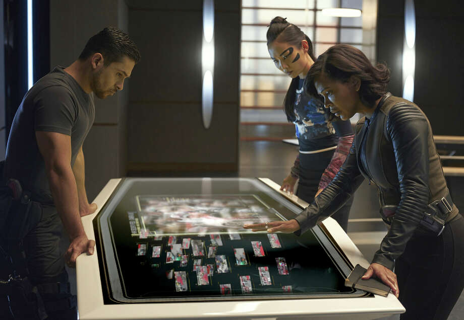 "Above: Wilmer Valderrama (left), Li Jun Li and Meagan Good star in ""Minority Report."" Left: Daniel London plays Wally, the caretaker of the pre- cognitives."
