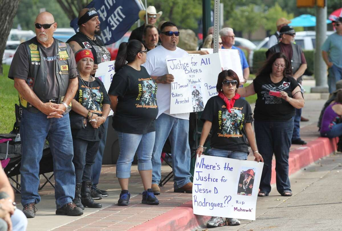 Bikers gather near the McLennan county courthouse to show support for fellow bikers involved in the Twin Peaks shootout, Aug. 22, 2015, in Waco, Texas. Law enforcement officers cleared portions of downtown Waco during the bike rally after a suspicious ice chest was found near the downtown parking lot. The sheriff?'s office bomb squad deployed a robot Saturday to investigate the contents, but found no hazardous materials. (Jerry Larson/Waco Tribune-Herald via AP) MANDATORY CREDIT