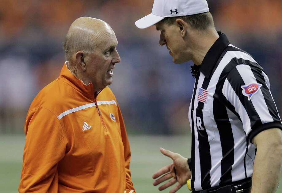 UTSA head coach Larry Coker, left, talks with an official during the first half on an NCAA college football game against Kansas State, Saturday, Sept. 12, 2015, in San Antonio. Photo: Eric Gay /Associated Press / AP