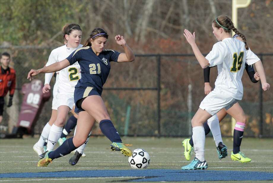 Junior Samantha LaValle (21) will be a key cog for the Notre Dame-Fairfield girls' soccer team this season as they look to return to the CIAC playoffs. Last season, the Lancers posted the first winning record in program history, going 15-6-1. Photo: H John Voorhees III / The News-Times