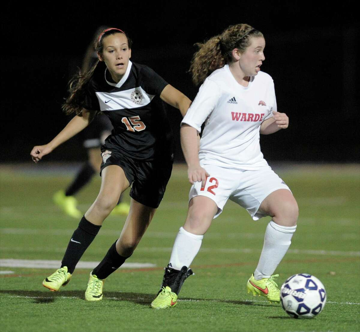 Warde's Anna Glovin (12) controls the ball against Ridgefield in last year's CIAC tournament. The Mustangs fell in the Class LL championship in double overtime to Glastonbury. Glovin is one of many returnees for coach Tom Cunningham this season.