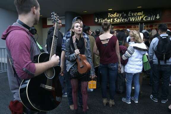 Seth O'Neal (left) and Rebecca Schwab wait in line to register for the American Idol audition at the Cow Palace in Daly City, Calif. on Tuesday, Sept. 15, 2015.