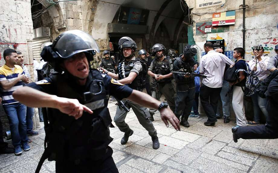 TOPSHOTS Israeli police use stun grenades as they start to disperse Palestinian demonstrators in a street of the Muslim quarter in Jerusalem's Old City during scuffles with Israeli riot police on September 15, 2015. Muslims and Israeli police clashed at Jerusalem's flashpoint Al-Aqsa mosque compound for a third straight day as Jews celebrated their new year and protesters vowed to protect Islam's third-holiest site. AFP PHOTO / THOMAS COEXTHOMAS COEX/AFP/Getty Images Photo: Thomas Coex, AFP / Getty Images