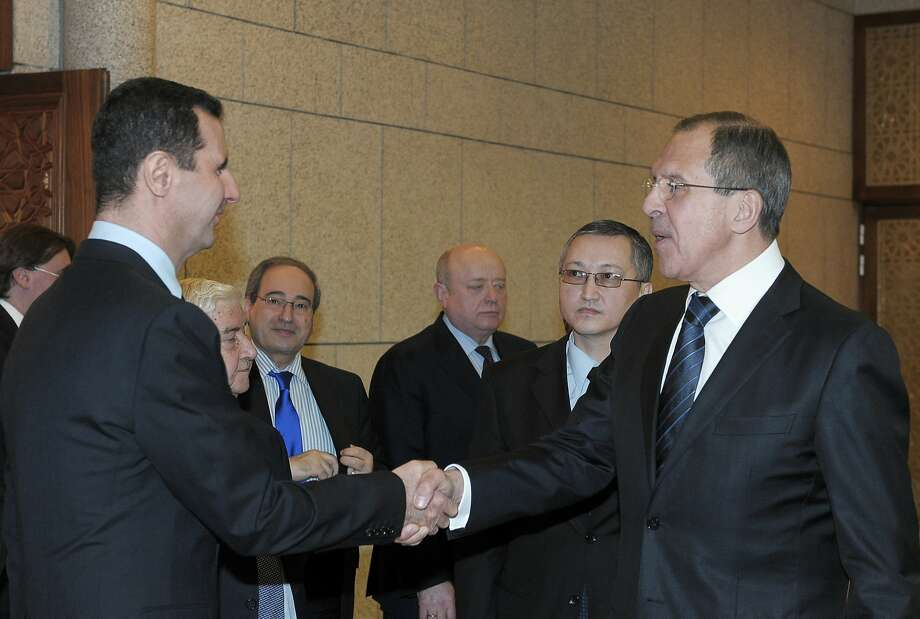 FILE - In this Feb. 7, 2012 file photo, Syrian President Bashar Assad, left, shakes hands with Russian Foreign Minister Sergey Lavrov after talks in Damascus, Syria. In ramping up its military involvement in Syria's civil war, Russia appears to be betting that the West, horrified by Islamic State's atrocities, may be willing to tolerate Assad for a while, perhaps as part of a transition. Photo: Uncredited, Associated Press